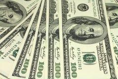 Bakgrund för få amerikansk dollar Arkivfoto
