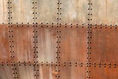 Bakgrund för fastnitade plattor för skeppstål Royaltyfri Foto