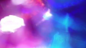 Bakgrund för festligt neon för klubba abstrakt, ljusa genomdränkta regnbågsskimrande färger arkivfilmer