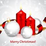 Bakgrund för glad jul med röda stearinljus och decoratio Royaltyfria Bilder