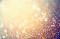 Bakgrund för guld- ferie för jul glödande Arkivbild