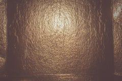 Bakgrund för guld- folie Arkivfoto