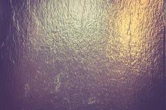 Bakgrund för guld- folie Arkivbild