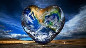 Bakgrund för hjärtaformjord Arkivfoto