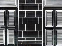 Bakgrund för hotellbyggnadsfönster Royaltyfri Bild