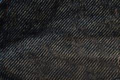 Bakgrund för Jean tygtextur, någon del av den korta blåa jeanpannan royaltyfria bilder