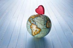 Bakgrund för jordklot för förälskelsehjärtavärld Arkivbilder