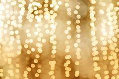 Bakgrund för lyckligt nytt år för jul för belysningbokeh guld- ljus, guld- färgbakgrund för glamour, suddigt nattljus för gul gul Royaltyfri Fotografi