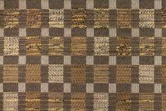 Bakgrund för mörk brunt med geometriska modeller Arkivbild