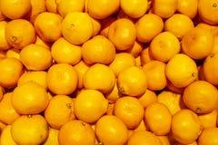 Bakgrund för marknad för mandarinapelsiner Arkivfoto