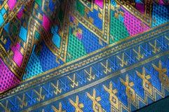 Bakgrund för modell Asien för siden- tyg Arkivbild