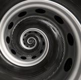 Bakgrund för modell för fractal för spiral för abstrakt begrepp för billastbilhjul Automatisk spiral bakgrund för upprepande bil  Arkivbild