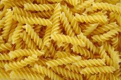 Bakgrund för pastaFusilli textur Arkivbild