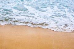 Bakgrund för sandstrandvatten Fotografering för Bildbyråer