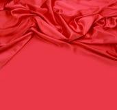 Röd bakgrund för silk tyg Arkivfoto