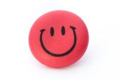 Bakgrund för Smileyframsidaboll på den vita bakgrunden Fotografering för Bildbyråer