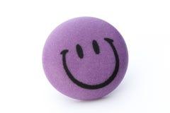 Bakgrund för Smileyframsidaboll på den vita bakgrunden Royaltyfria Bilder