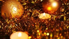 Bakgrund för stearinljus för nytt år för jul guld- mousserande arkivfilmer