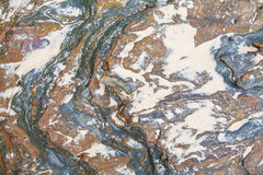 Bakgrund för sten- och sandtexturcloseup arkivbild