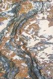 Bakgrund för sten- och sandtexturcloseup royaltyfri foto