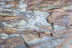 Bakgrund för sten- och sandtexturcloseup royaltyfria bilder