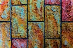 Bakgrund för stenvägg med färgrika texturer royaltyfri foto