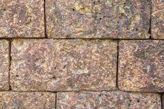 Bakgrund för stenvägg, textur, med den bruna tonen Fotografering för Bildbyråer