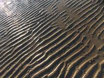 Bakgrund för strand sand Arkivbild