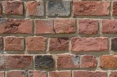 Bakgrund för tegelstenvägg med röda tegelstenar Arkivfoto