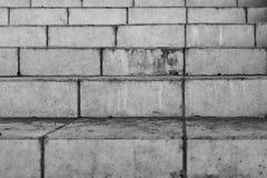 Bakgrund för tegelstenvägg som är svart i vitt royaltyfri fotografi