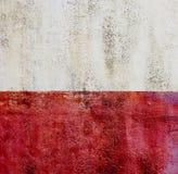Bakgrund för textur för Colorfull vibrerande utomhus- gropig röd tappningvägg Fotografering för Bildbyråer