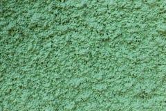 Bakgrund för textur för betongväggdrakgräsplan Arkivfoton