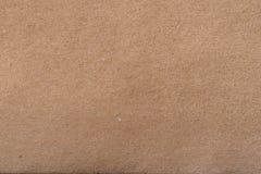 Bakgrund för textur för brunt papper för hantverk Royaltyfri Foto