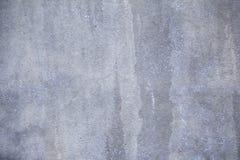 Bakgrund för textur för grå färgbusesten Arkivbild