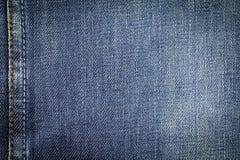 Bakgrund för textur för grov bomullstvilljeanstyg med sömmen för design Royaltyfria Foton