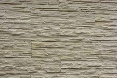 Bakgrund för textur för stenvägg i ljuset av forntida kräm- beigabrunt Royaltyfri Bild