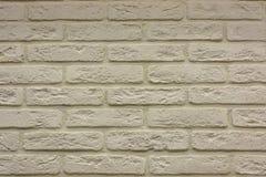 Bakgrund för textur för tegelstenvägg i ljuset av forntida kräm- beigabrunt Royaltyfri Foto