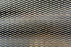 Bakgrund för textur för hål för metallingreppscirkel Fotografering för Bildbyråer