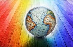 Bakgrund för världsregnbågejordklot Arkivbilder