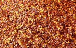 bakgrund för varma kryddor med chilipaprika Arkivbilder
