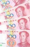 Bakgrund för 100 Yuan räkningar Arkivfoton