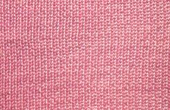Bakgrund från den rosa stockineten Arkivfoton