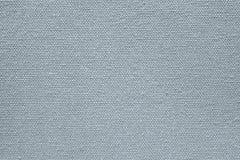 Bakgrund från en grov kanfas av silvrig färg Royaltyfri Foto