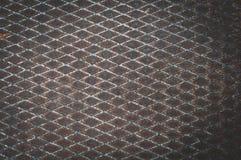 Bakgrund från ett gammalt ark av metall med en diamanttextur royaltyfria foton