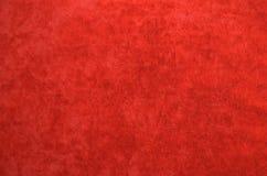 Bakgrund från ett rött perfekt mockaskinntyg Royaltyfria Bilder