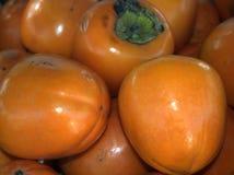 Bakgrund från fruktpersimon Sale av mogen frukt marknad Arkivfoton