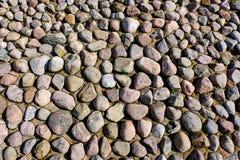 Bakgrund från havsstenar i sanden Fotografering för Bildbyråer