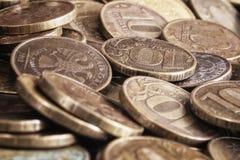 Bakgrund från mynt av 10 rubel av banken av Ryssland Royaltyfria Bilder