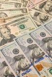 Bakgrund från pappers- dollar av olik fördel Arkivbild
