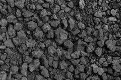 Bakgrund från svart jord texturerad yttersida Jord består av a Royaltyfria Bilder